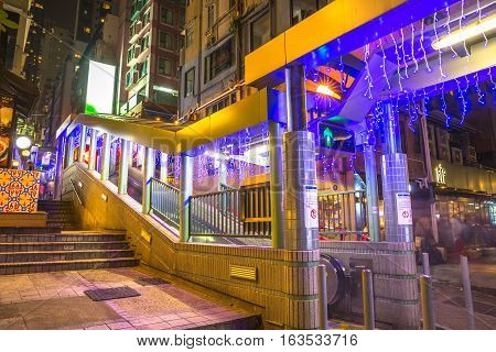 Hong Kong, China - December 10, 2016: the popular Central-Mid-Levels escalator in Soho historic district, Central Hong Kong, famous for bars, restaurants, clubs and nightlife.