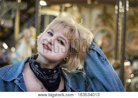 Bucolic portrait of beautiful girl over carousel background