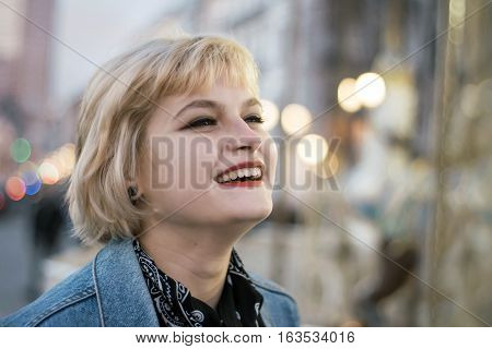 Bucolic Portrait Of Smiling Cute Young Girl  Over City Lights Background