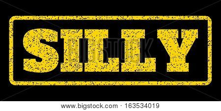 Yellow rubber seal stamp with Silly text. Vector tag inside rounded rectangular frame. Grunge design and dust texture for watermark labels. Horisontal sticker on a blue background.