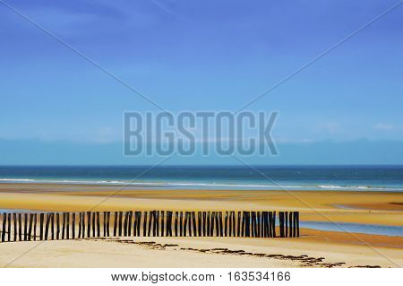 Beautiful Sand Dune with Blue Sky and Pretty Fence