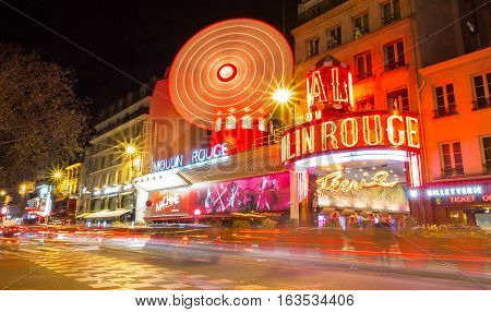 Paris France-December 28; 2016 : The cabaret Moulin Rouge is located close to Montmartre in the Paris district of Pigalle on boulevard Clichy in the 18th arrondissement .
