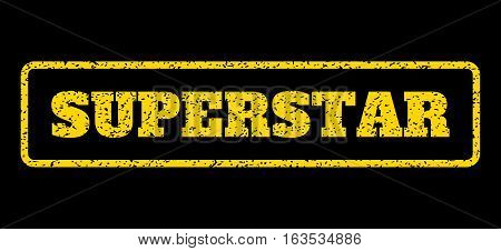 Yellow rubber seal stamp with Superstar text. Vector caption inside rounded rectangular frame. Grunge design and scratched texture for watermark labels. Horisontal sticker on a blue background.