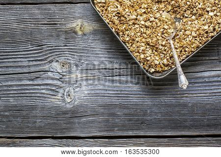 Roast on a baking granola for breakfast comfort of your home. Top view. Healthy home food concept.