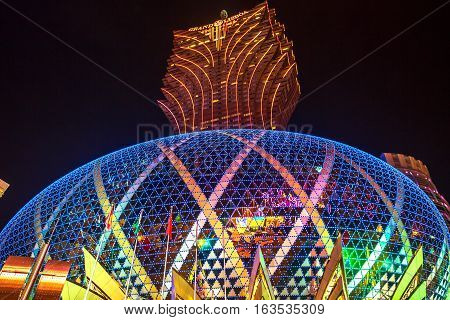 Macau, China - December 8, 2016: the iconic tallest tower in Macao and the big dome of the Grand Lisboa, the largest casino in the world by extension, illuminated at night.