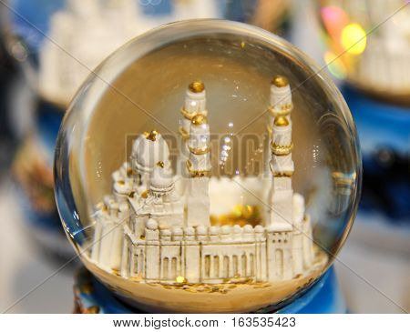 This is a snow globe with a mosque.