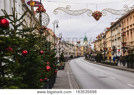 Warsaw, Poland - December 25th, 2016. Christmas decorations on Nowy Swiat street in Warsaw Old town at Xmas day.