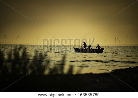 fishing boat in the sea at sunset