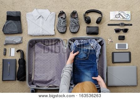 The woman collects a suitcase for travel and leisure