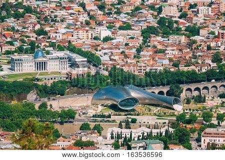 Tbilisi, Georgia - May 20, 2016: Aerial View Of Concert Music Theatre Kura Mtkvari River Rike Park And Presidential Palace Avlabari Residence Surrounded By Populous Residential Area In Sunny Summer.