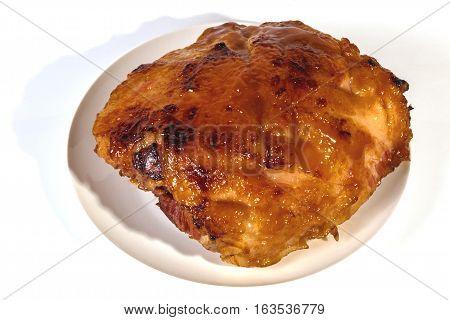 Baked Gammon Covered In Honey Based Glaze On White Plate