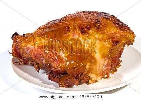 Baked Gammon Covered In Sweet Glaze On White Plate
