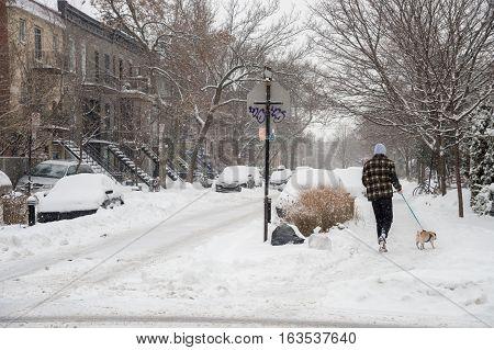 Montreal CA - 12 December 2016: Pedestrians in Montreal's Plateau Neighbourhood