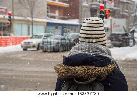 Montreal CA - 12 December 2016: Snowstorm in Montreal. Pedestrians in Mile End Neighbourhood