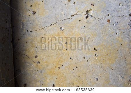 Crack and many small holes on Concrete wall