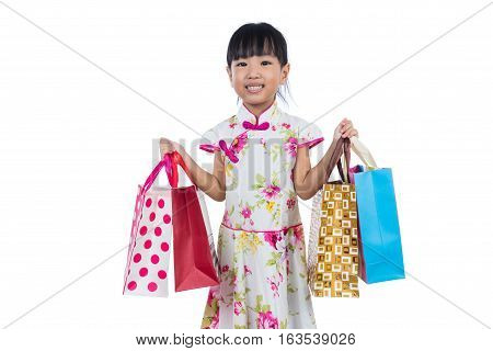 Asian Chinese Little Girl Wearing Cheongsam Holding Shopping Bags