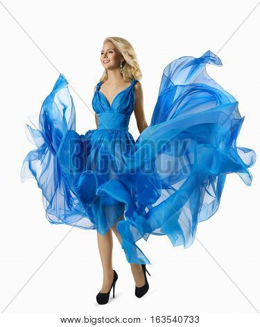 Fashion Woman in Blue Dress Flying Fabric Elegant Girl Walking in Waving Gown Flowing Cloth over white background