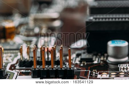 Transistors Capacitors Resistors And Other Electronic Components Mounted On Motherboard Macro Closeu