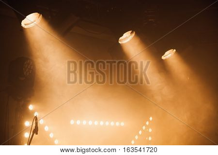 Spot Lights With Yellow Rays In The Dark