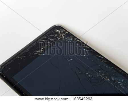 broken glass display of old smart phone