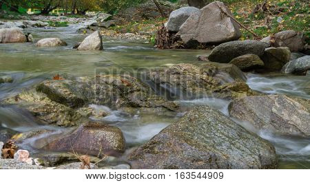 Beautiful landscape of  a creek.Scenic view of a creek at mountains foot. Greece. Winter
