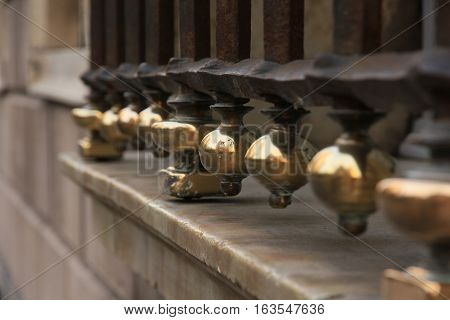 wrought-iron grille with copper tips and marble window sills