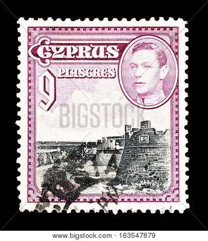 CYPRUS - CIRCA 1938 : Cancelled postage stamp printed by Cyprus, that shows King George VI Othello's Tower in Famagusta.