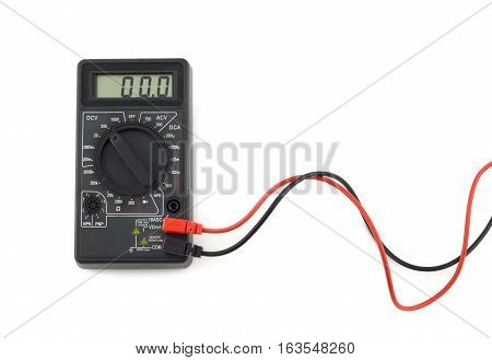 Digital multimeter with red and black wires shows zero on LCD display. Electronic multimeter isolated on white background close up