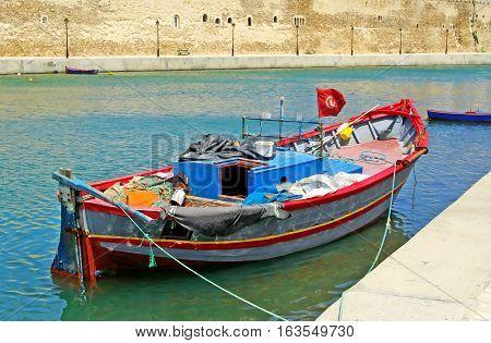 Boat near fort of Bizerte in Tunisia