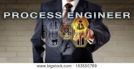 Manager in blue suit highlighting PROCESS ENGINEER via touch on an interactive computer screen. Oil and gas industry metaphor and offshore role concept for an experienced refinery project engineer.