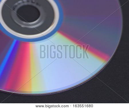 Stack of computer DVD disks isolated on black closeup