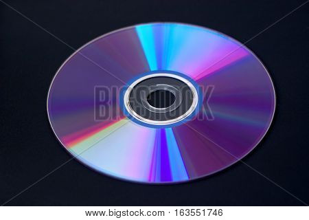 Computer DVD disks isolated on black closeup