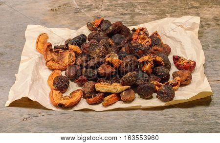 a handful of dried fruit. Wooden background