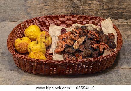 a handful of dried fruit in a wicker basket