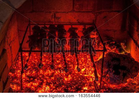 Burning Fireplace And Barbecue Pork