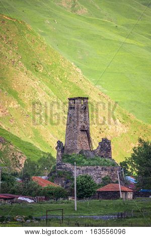Medieval watch tower in village Sno (Sno castle) Kazbegi region Georgia.