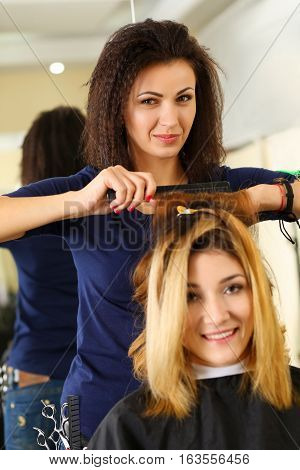 Beautiful Hairdresser Hold Scissors And Comb