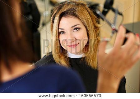 Female Hairdresser Hands Holding Scissors