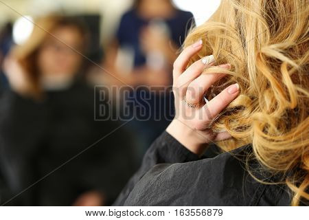 Blonde Woman At Hairdresser Checking Her Hairdo