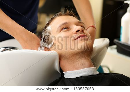 Female Hands Washing Hair To Handsome Smiling Man