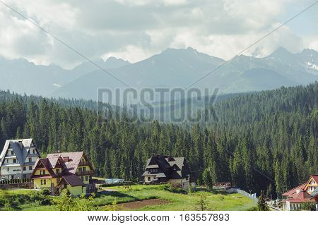 Guest House In The Traditional Mountain Style And Mountain Landscape.