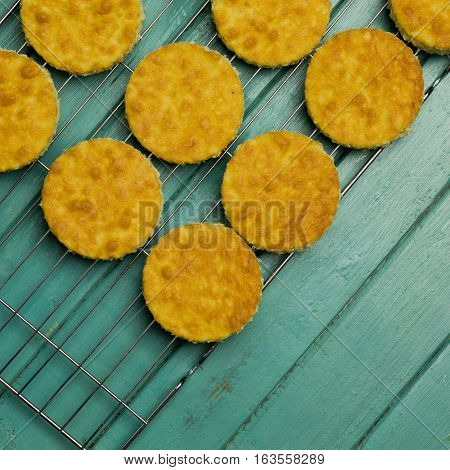 Coconut Orange Biscuit Cake Cut Outs On Cooling Net