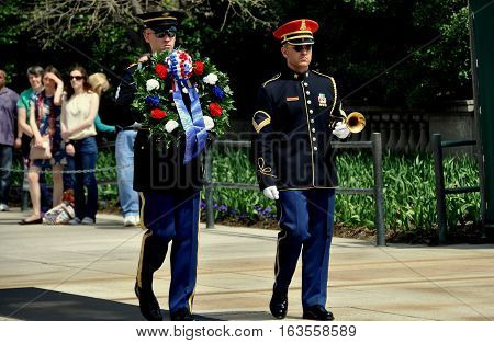 Arlington Virginia - Apro;l 12 2014: Two U.S. Marines changing the floral wreath ceremony at the Tomb of the Unknown Soldier in Arlington National Cemetery