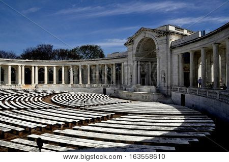 Arlington Virginia - April 12 2014: The Memorial Amphitheatre with its curved colonnade and seating benches at Arlington National Cemetery