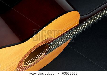 Close Up of Guitar on Black Background
