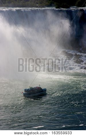 A ferry boat taking tourists to the base of Niagara Falls, Ontario, Canada