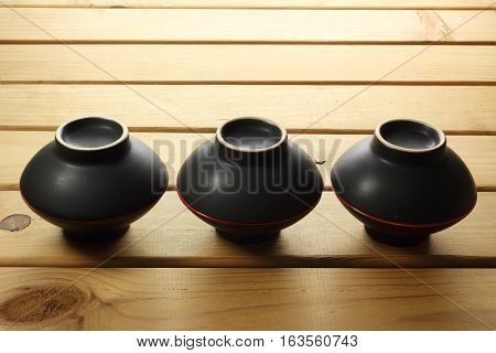 Stack of Bowls on a Wooden Background