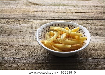 Bowl of French Fries on Wooden Background