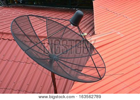 Satellite dish on the roof in rural village