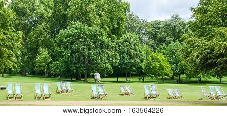 Deck Chairs stretched across Hyde Park, London